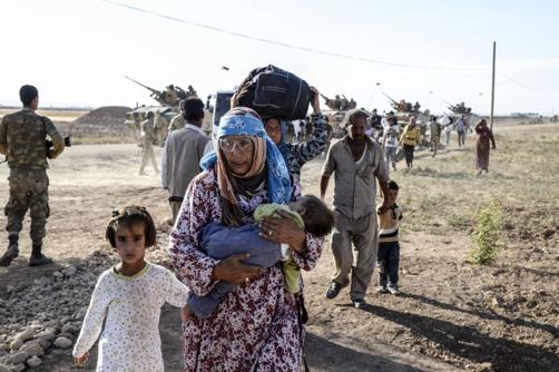 Fuga de refugiados Sírios em 2014.