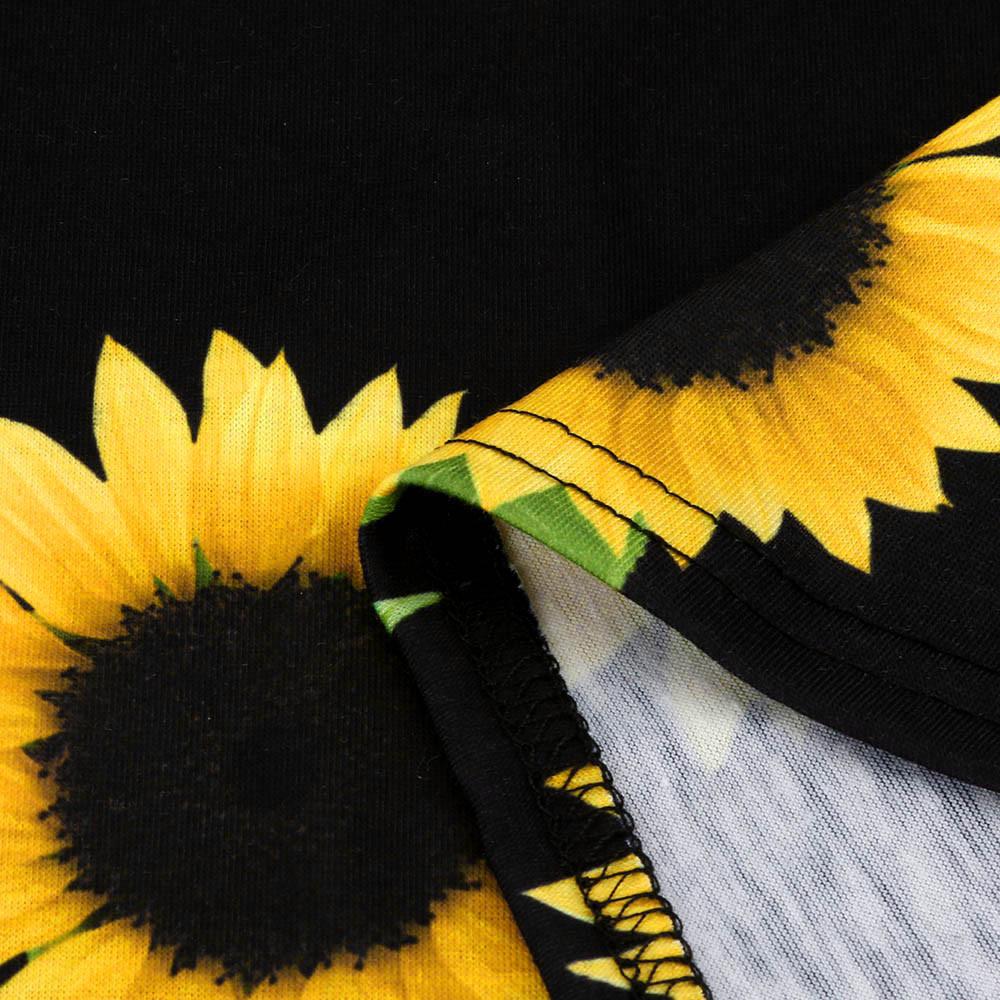 L'incontournable pull noir pour femme, à manches longues et imprimés tournesols, en vente sur Zappandoo.