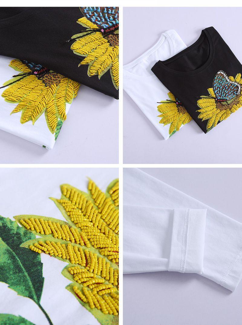 Pull en deux coloris; noir et blanc, dans une version brodée du tournesol, en vente sur Zappandoo.